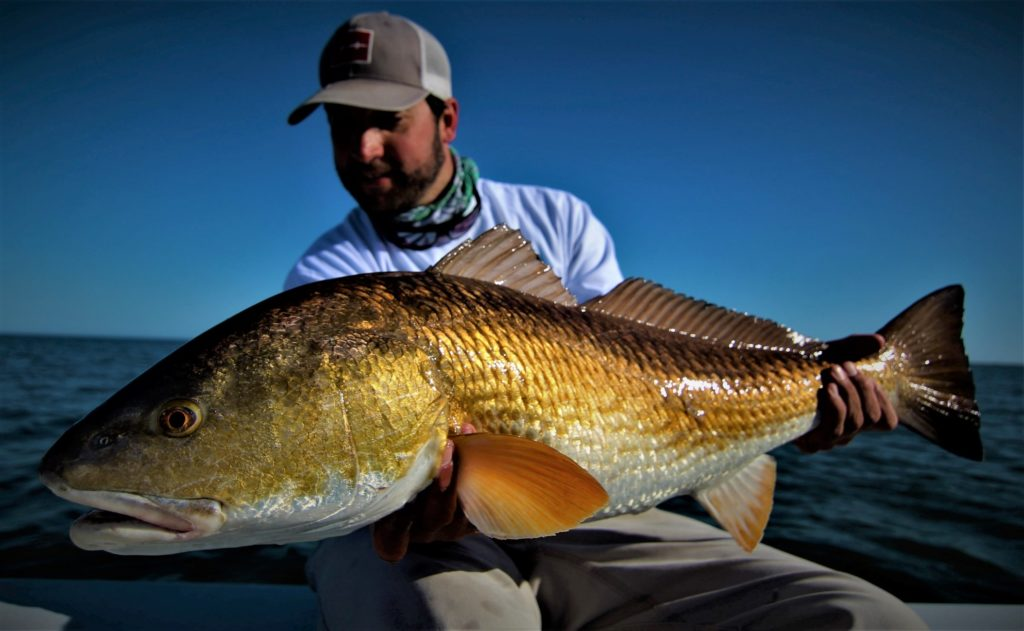 Kenny admiring his biggest Redfish to date.